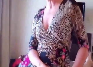 Mom in fishnet jerks off her son with passion